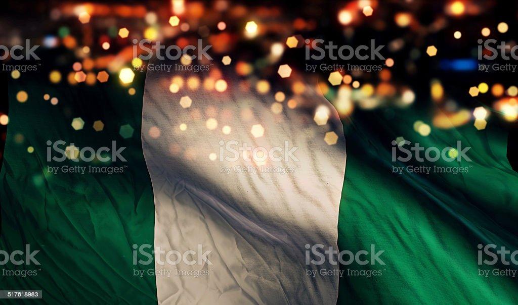 Nigeria National Flag Light Night Bokeh Abstract Background stock photo