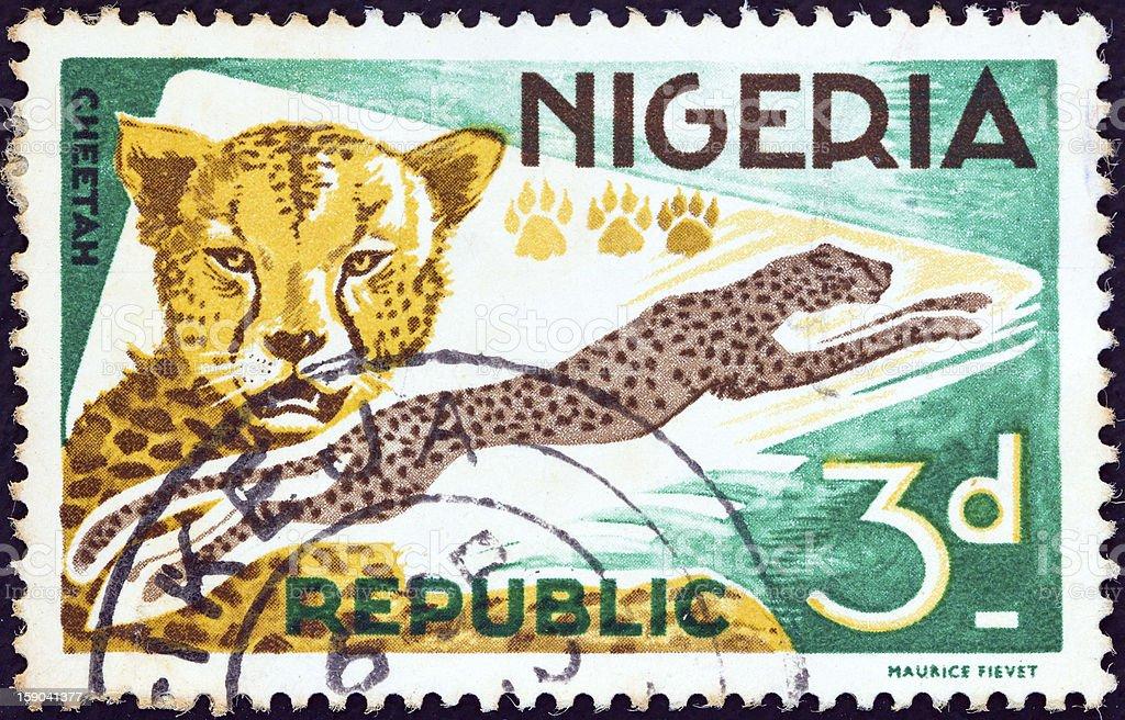 Nigerian stamp shows a Cheetah (Acinonyx jubatus) (1965) stock photo