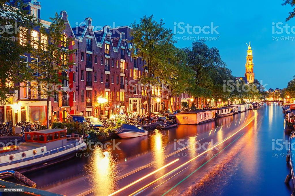 Night Amsterdam canal and Westerkerk church stock photo