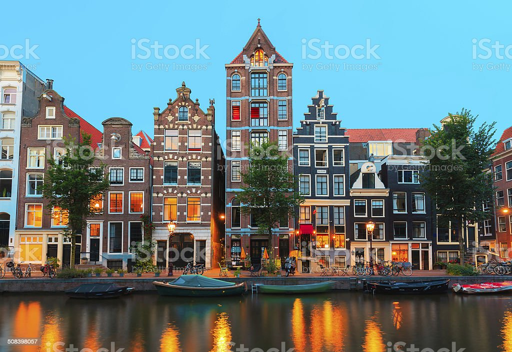 Night Amsterdam canals and typical houses, Holland, Netherlands stock photo