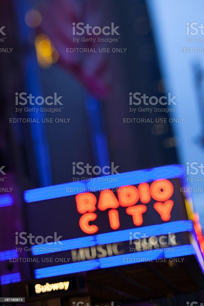Night blurred view of Radio City Music Hall neon sign stock photo