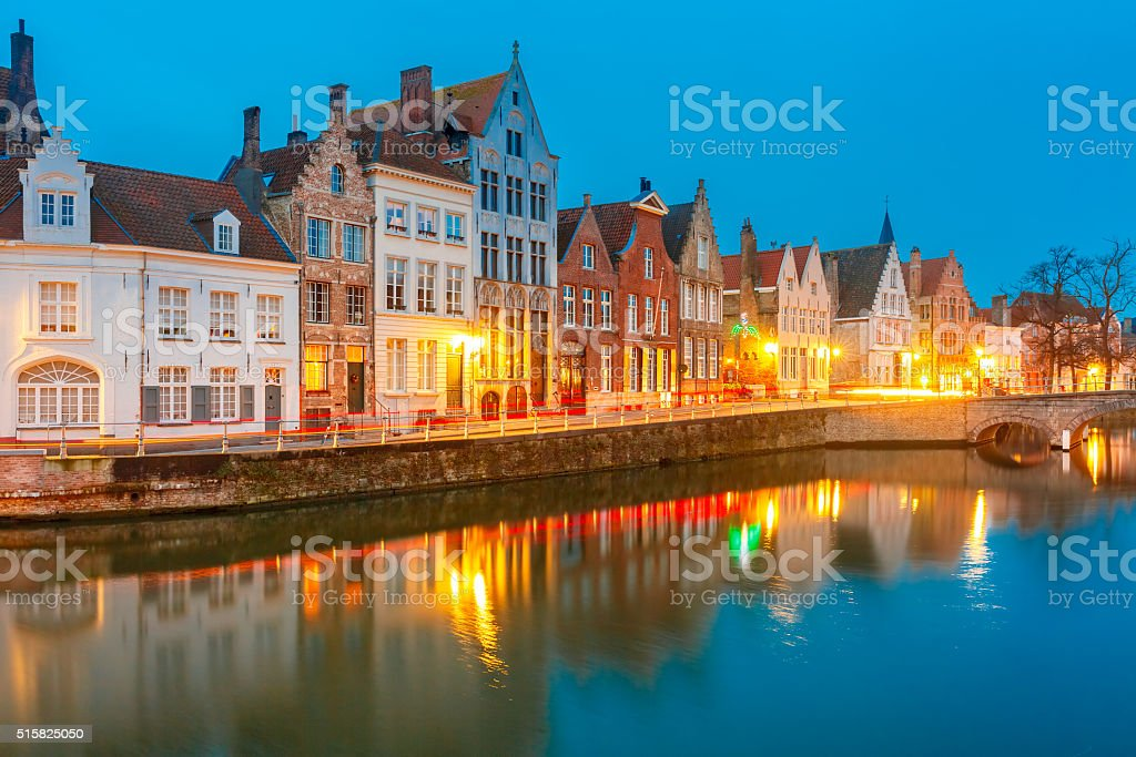 Night Bruges canal and bridge, Belgium stock photo