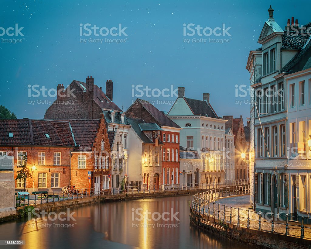 Night Bruges over the waters of Spiegelrei stock photo