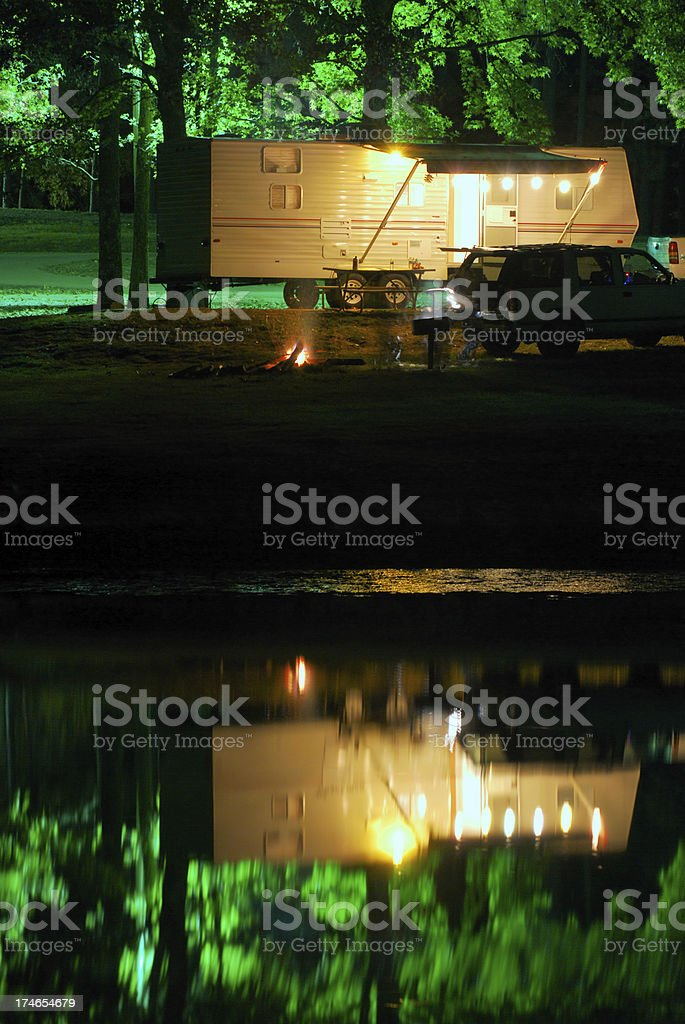 Night camping by lake in trailer royalty-free stock photo