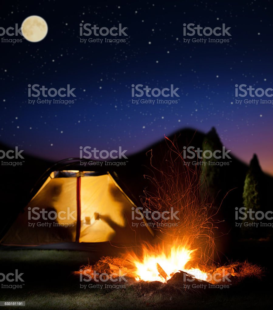 Night camping in the mountains. stock photo