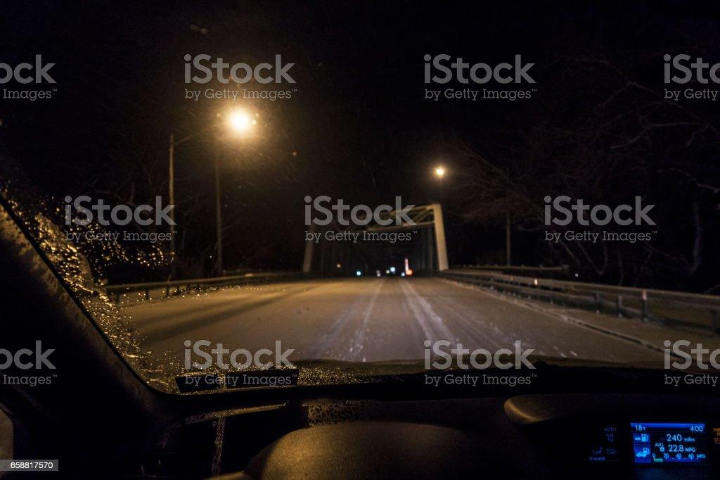 Night Car Driver POV Approaching Winter Erie Canal Bridge stock photo