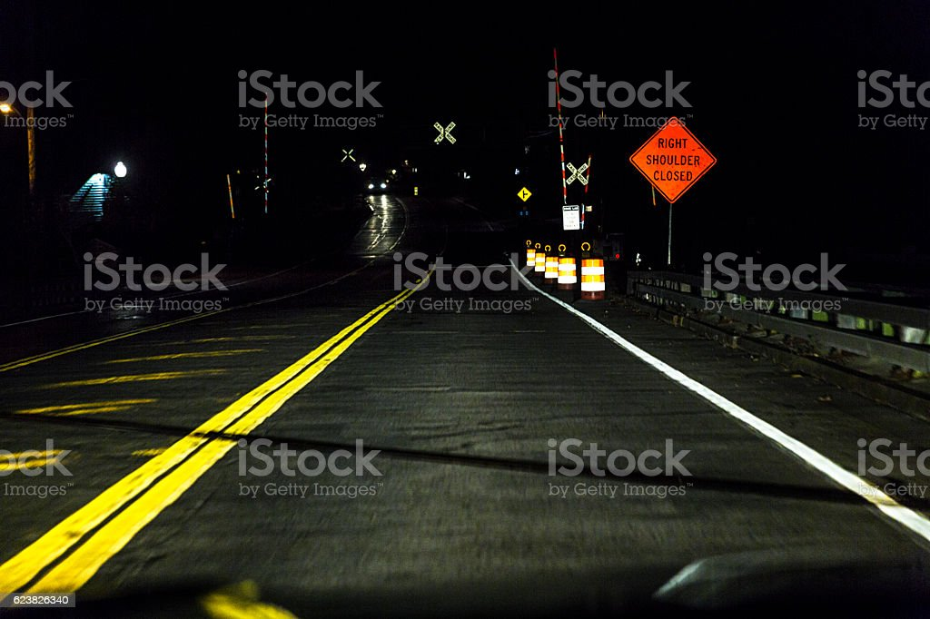 Night Car Driver Perspective Approaching Dark Railroad Crossing Road Intersection stock photo