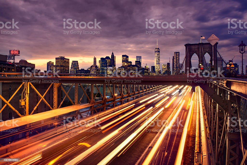 Night car traffic on Brooklyn Bridge in New York City stock photo