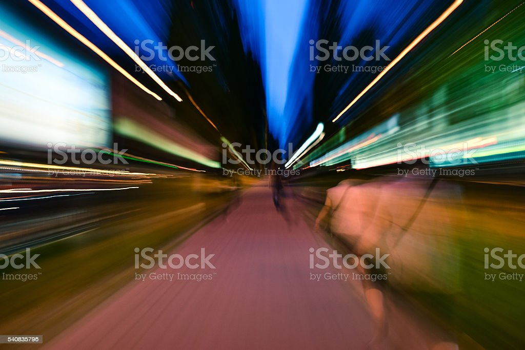 Night city accelerating blurred motion walking people. Speed concept stock photo