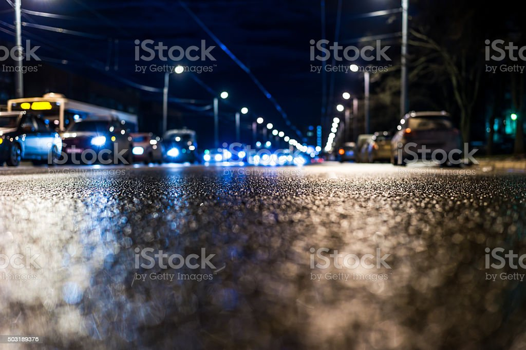 Night city after rain, view of the flow of cars stock photo