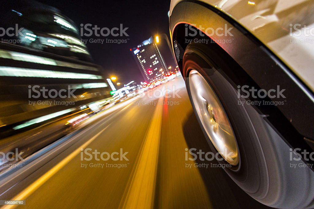 Night city from the car back view. stock photo