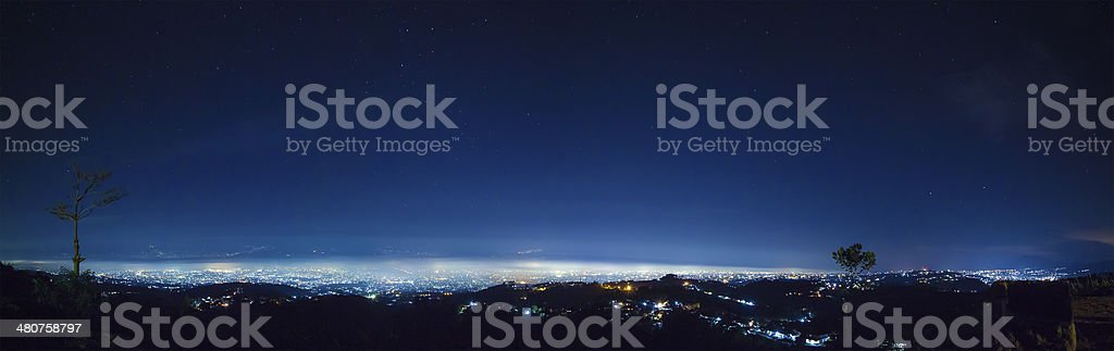 Night city panorama view from top of the hill stock photo