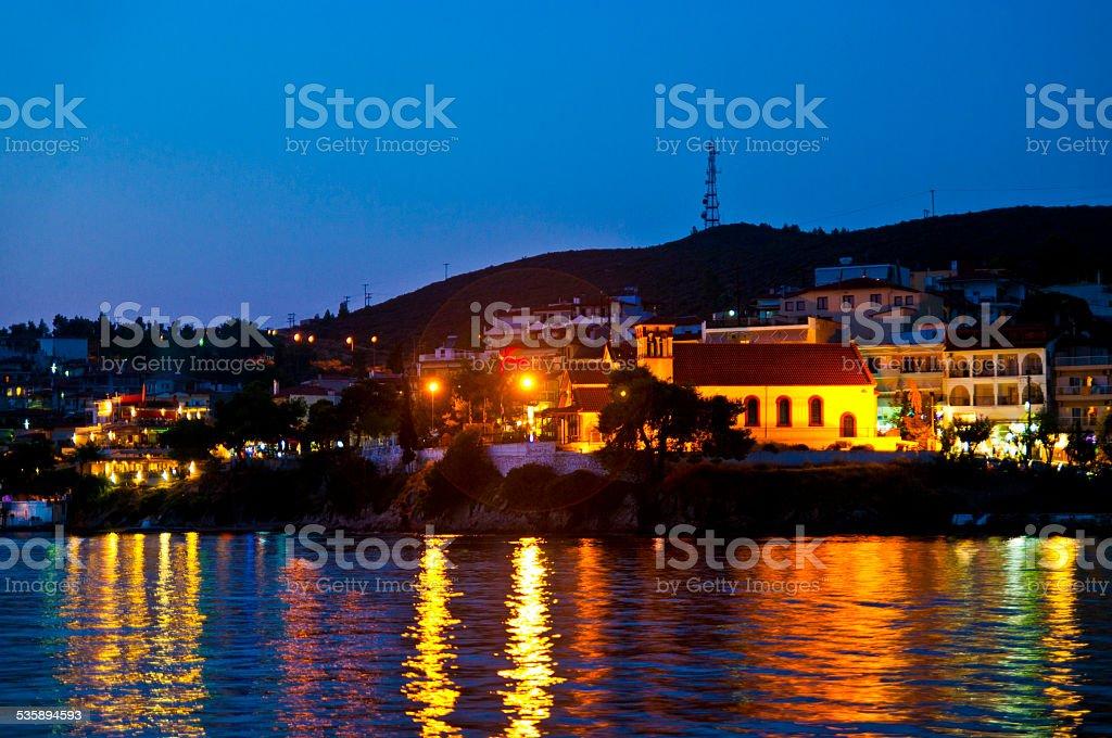 Night city scape in Neos Marmaras stock photo