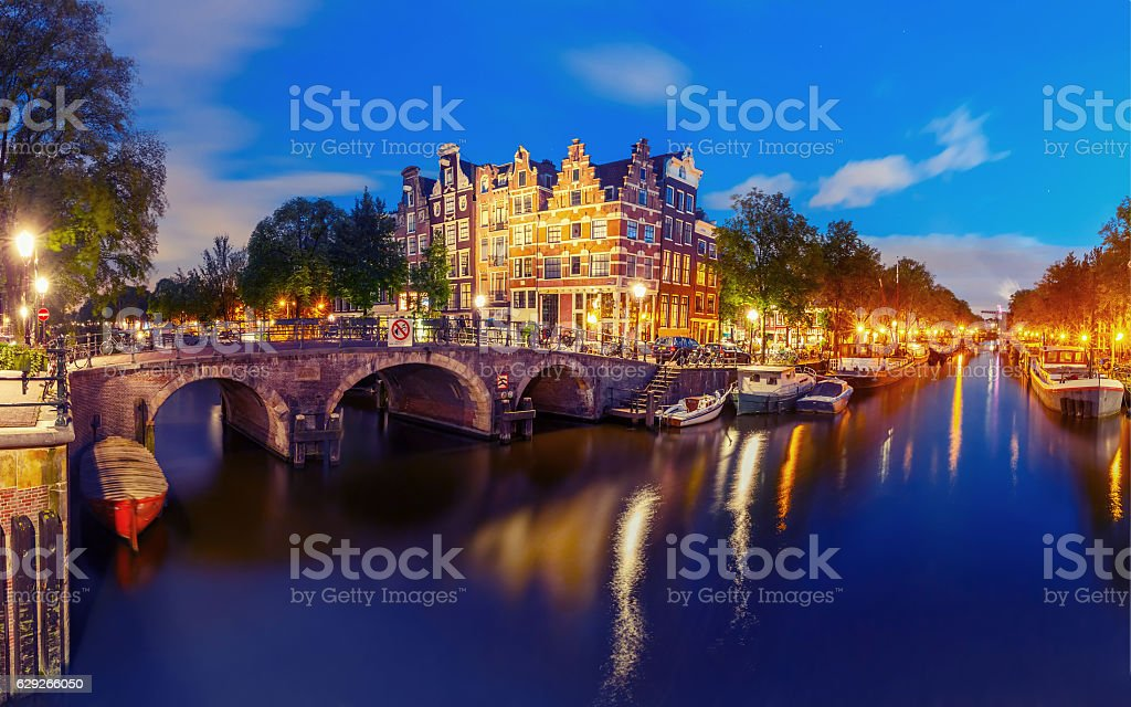 Night city view of Amsterdam canal and bridge stock photo
