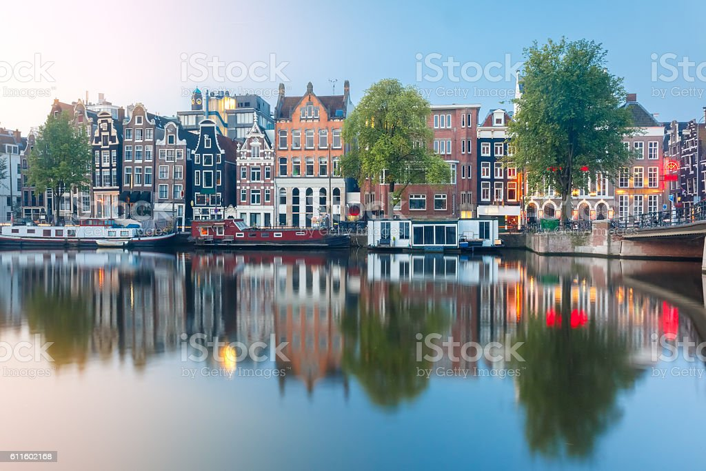 Night city view of Amsterdam canal with dutch houses stock photo