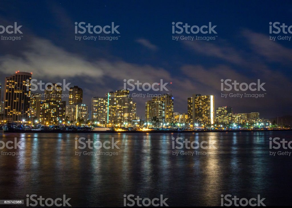 Night cityscape captured at Magic Island, Honolulu. stock photo