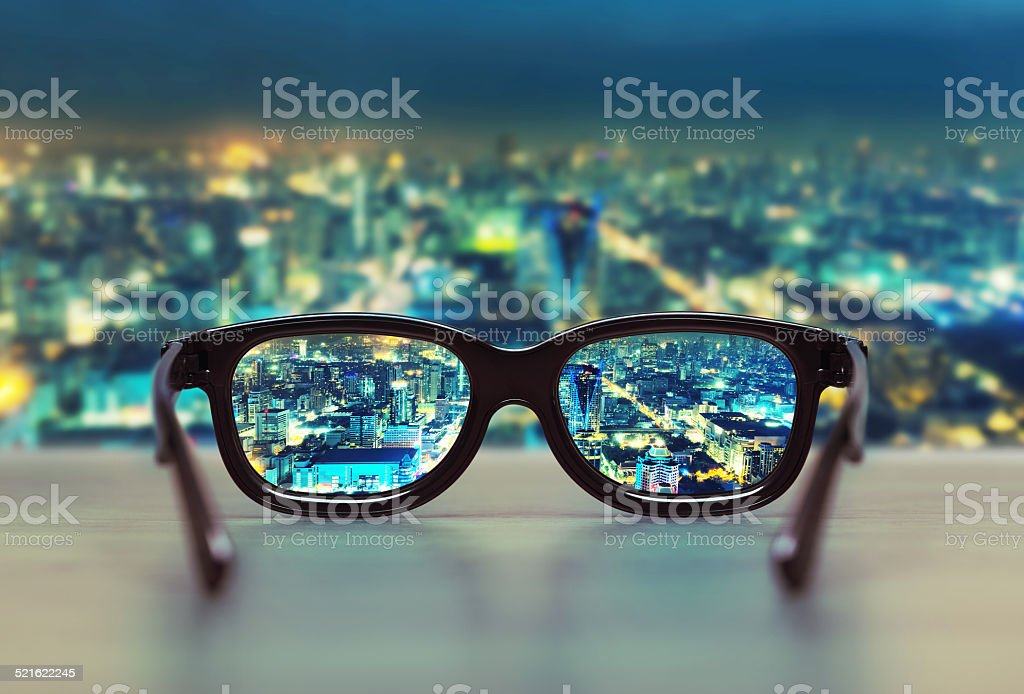 Night cityscape focused in glasses lenses stock photo