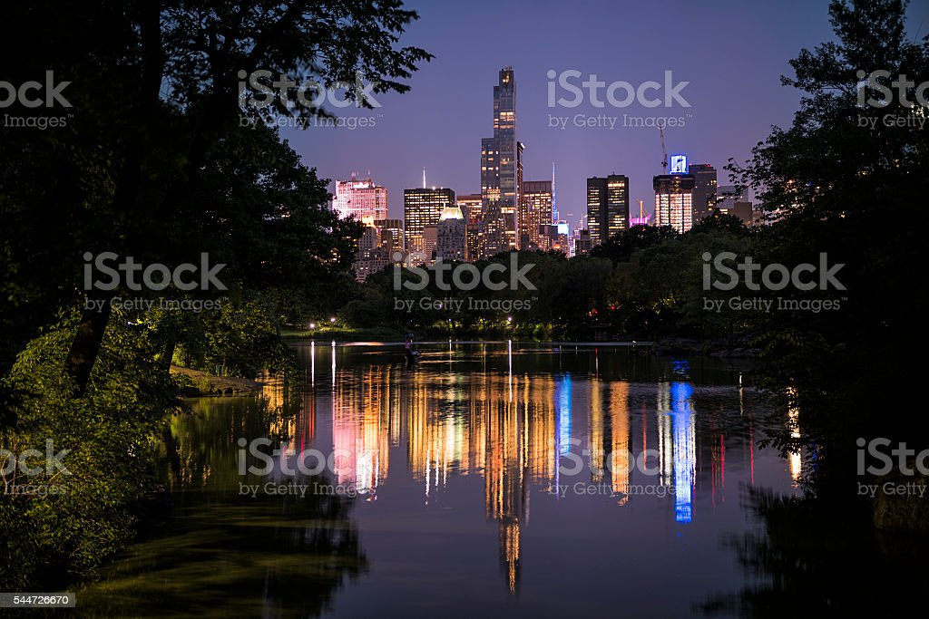 Night cityscape of Manhattan in Central Park from Oak Bridge stock photo