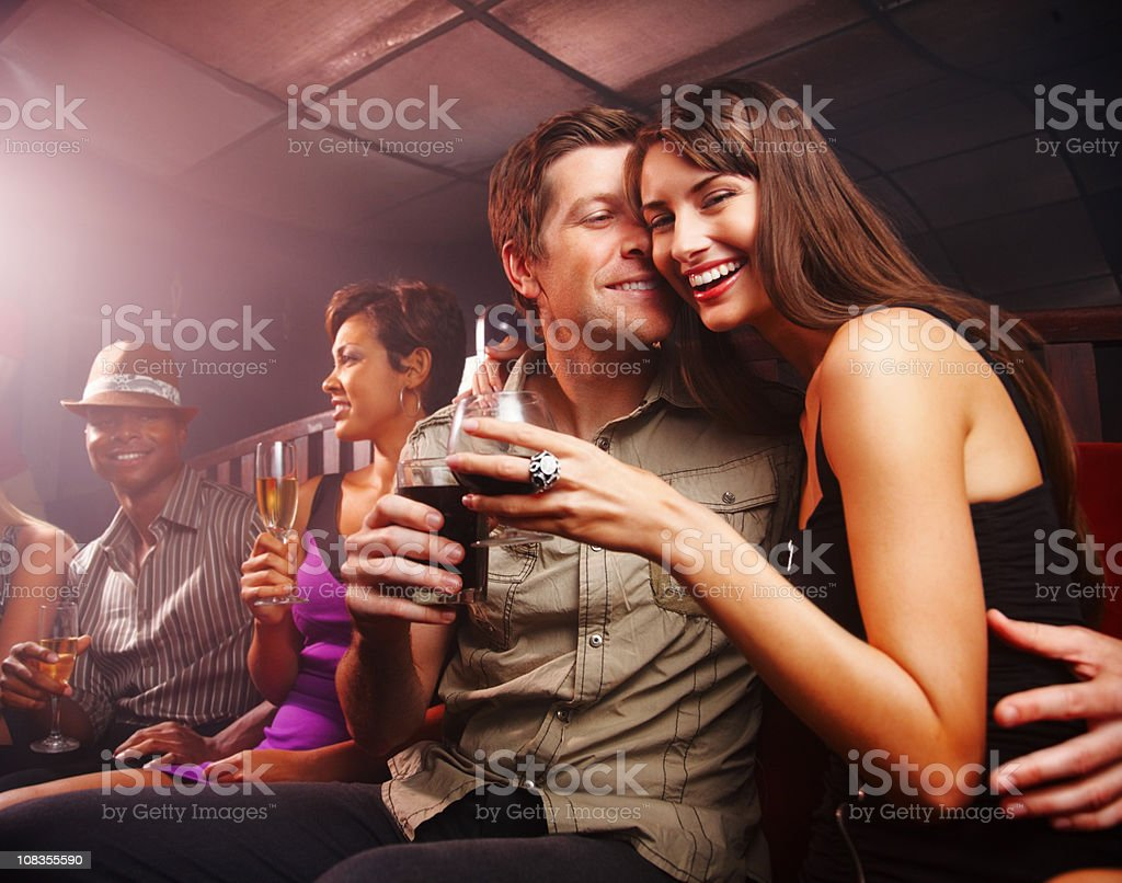 Night club celebration - Romantic couple with friends at party royalty-free stock photo