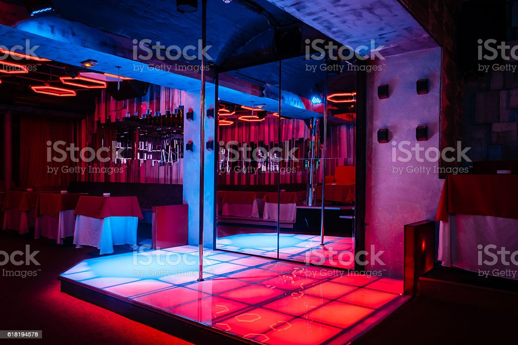 Night club interior with pole dance stage stock photo