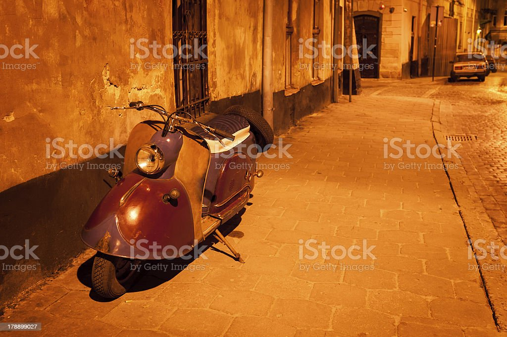 Night European street and scooter royalty-free stock photo