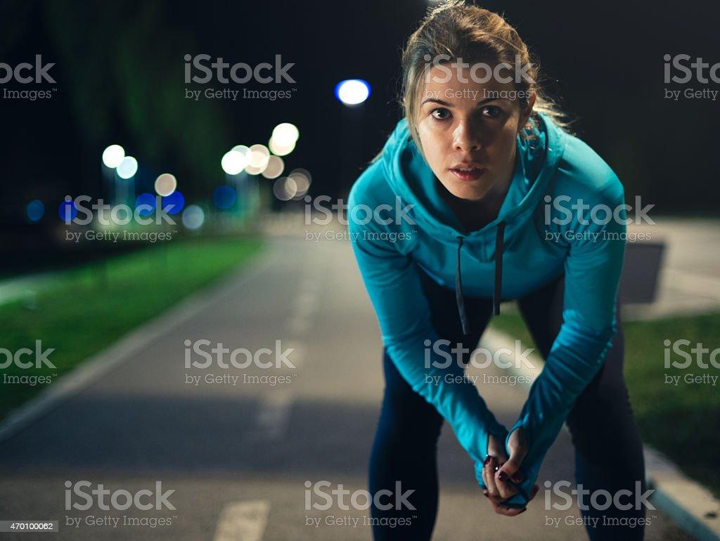 Night female runner stock photo