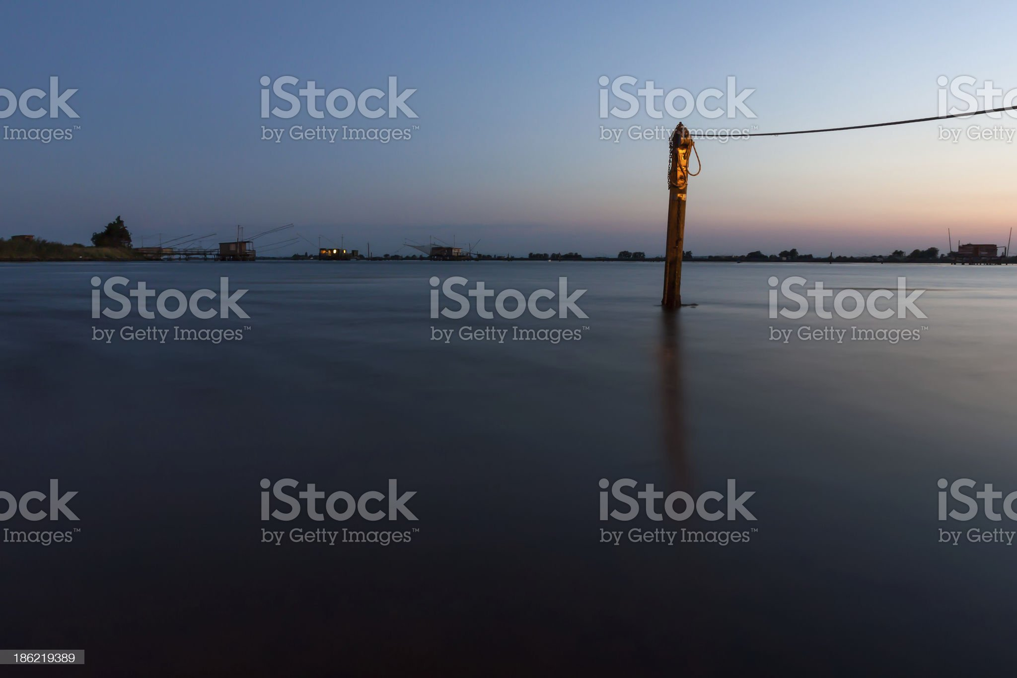 Night fishing on the lake, Italy royalty-free stock photo