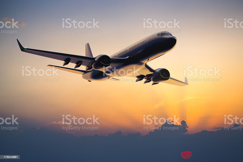 Night flight of a passenger jet airplane stock photo