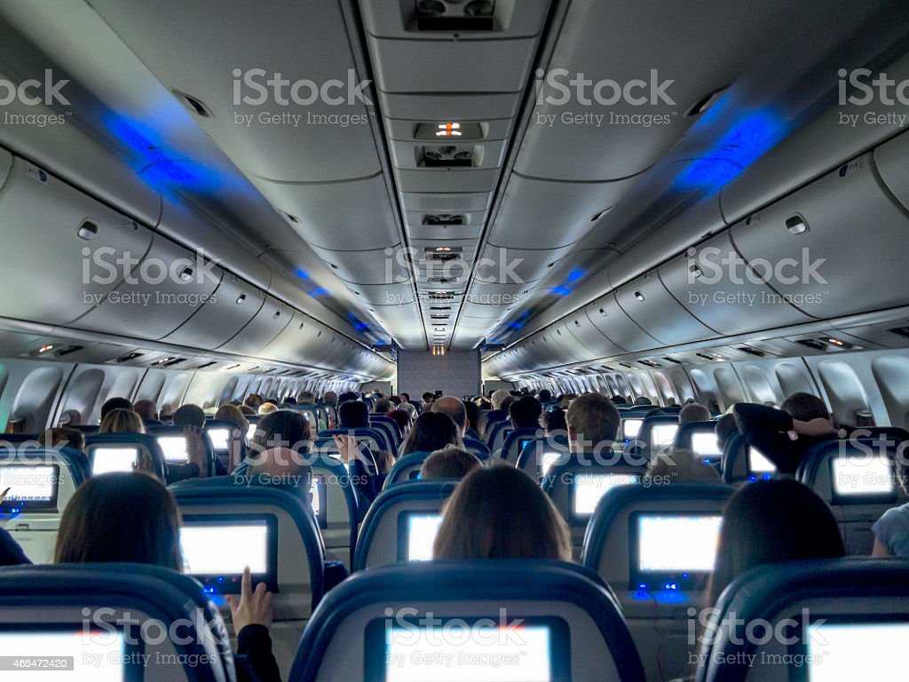Night flight on airplane, Entertainment system working stock photo
