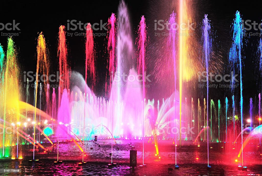 Night fountain lights show stock photo