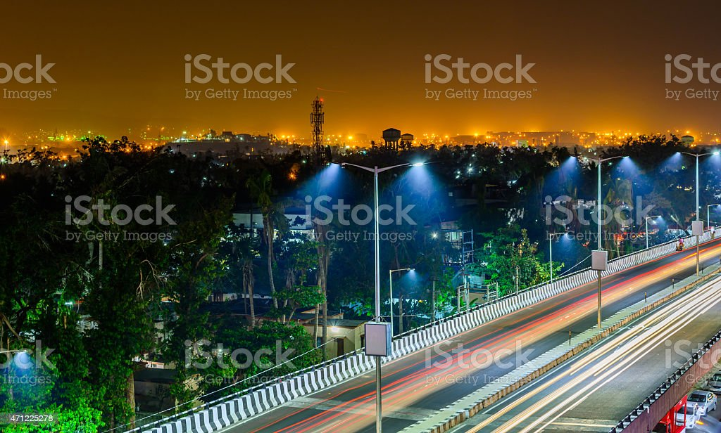Night Freeway With Car Traffic And Lights Trails stock photo