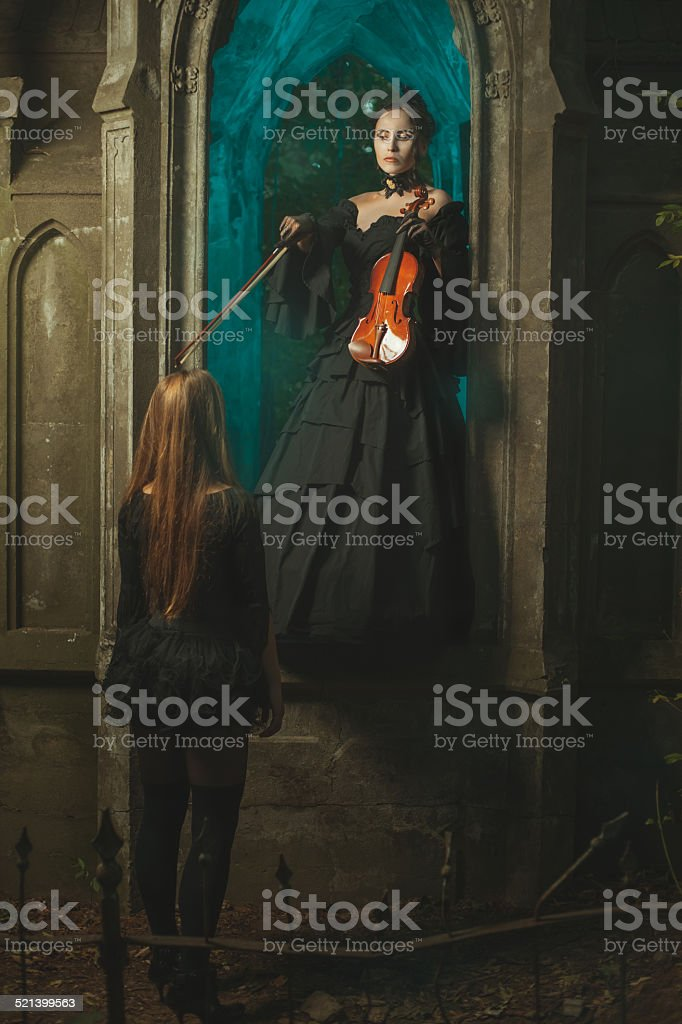 Night ghost girl arguing with another ghost. stock photo