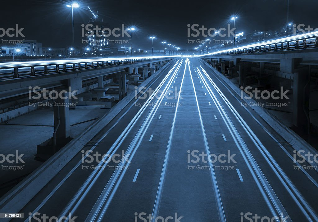 Night highway with viaducts stock photo