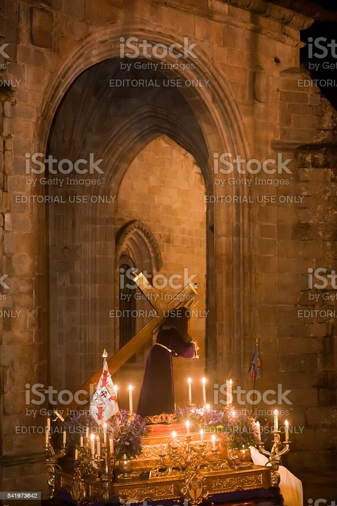 Night Holy Week parade, Lugo cathedral stone arch. stock photo