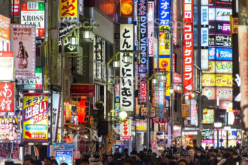 Night illumination a lot of advertising and crowd of people stock photo