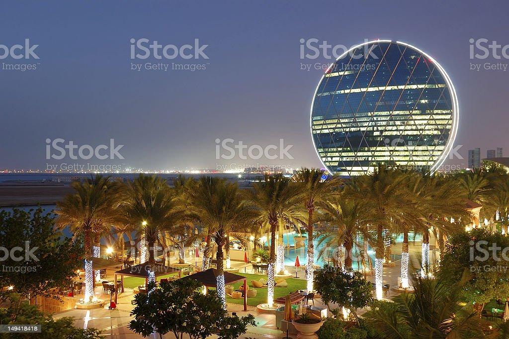 Night illumination in the luxury hotel and circular building stock photo