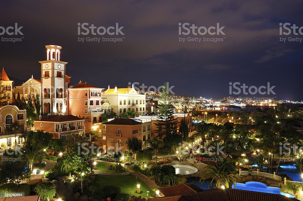 Night illumination of luxury hotel during sunset stock photo