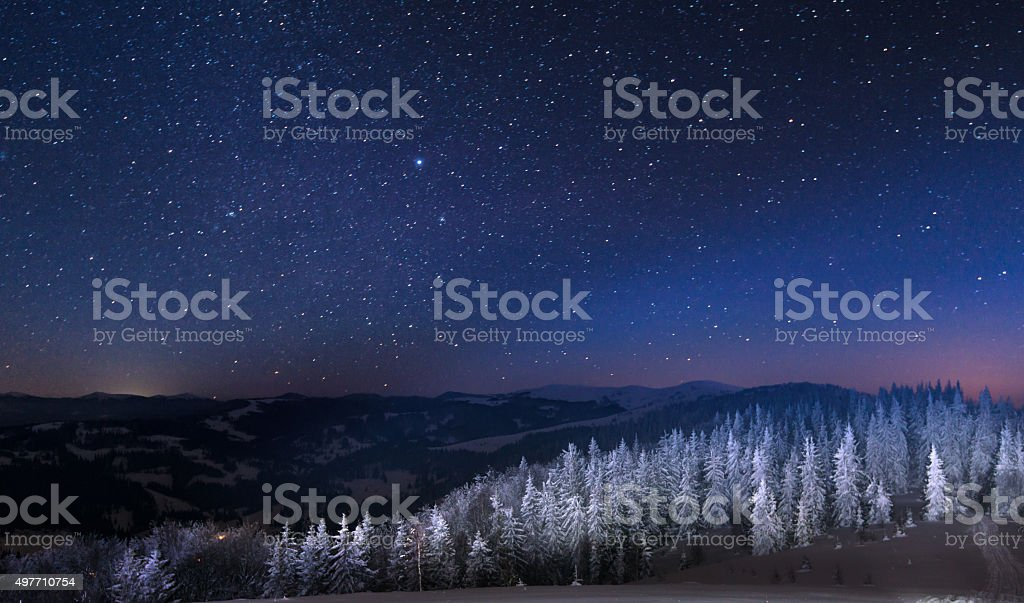 Night in the snowy mountains stock photo