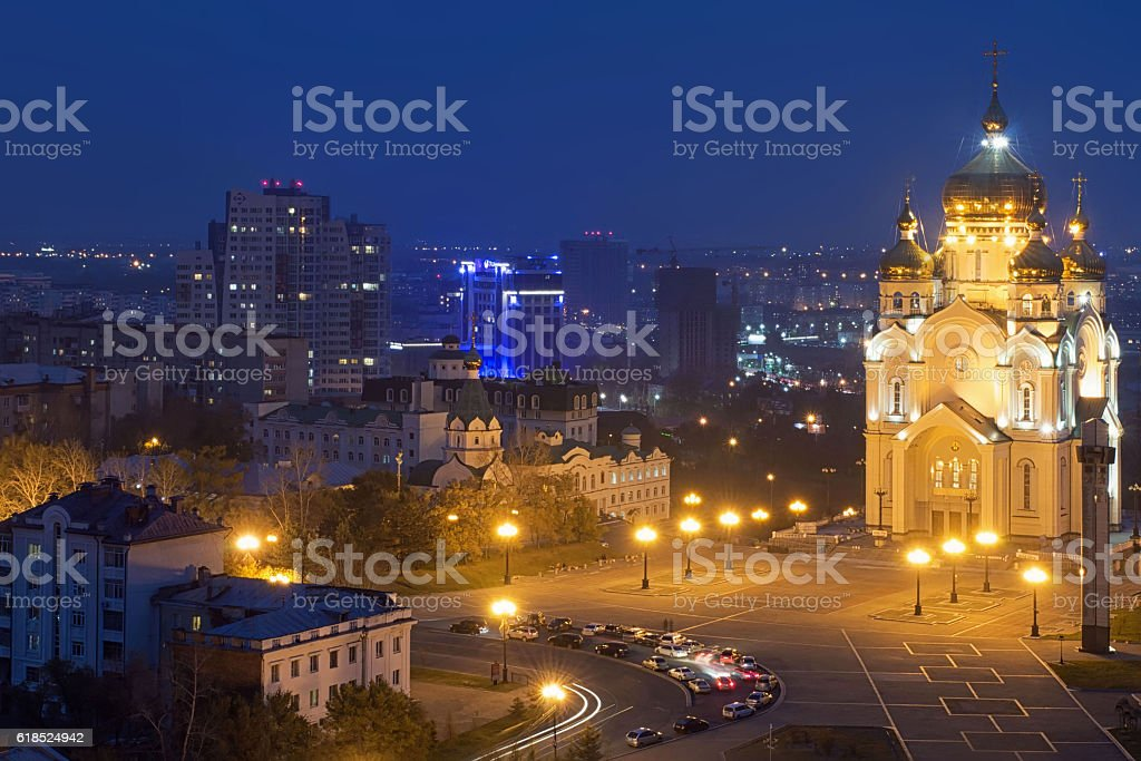 Night Khabarovsk in the smoke. The Transfiguration Cathedral. Far East, Russia stock photo