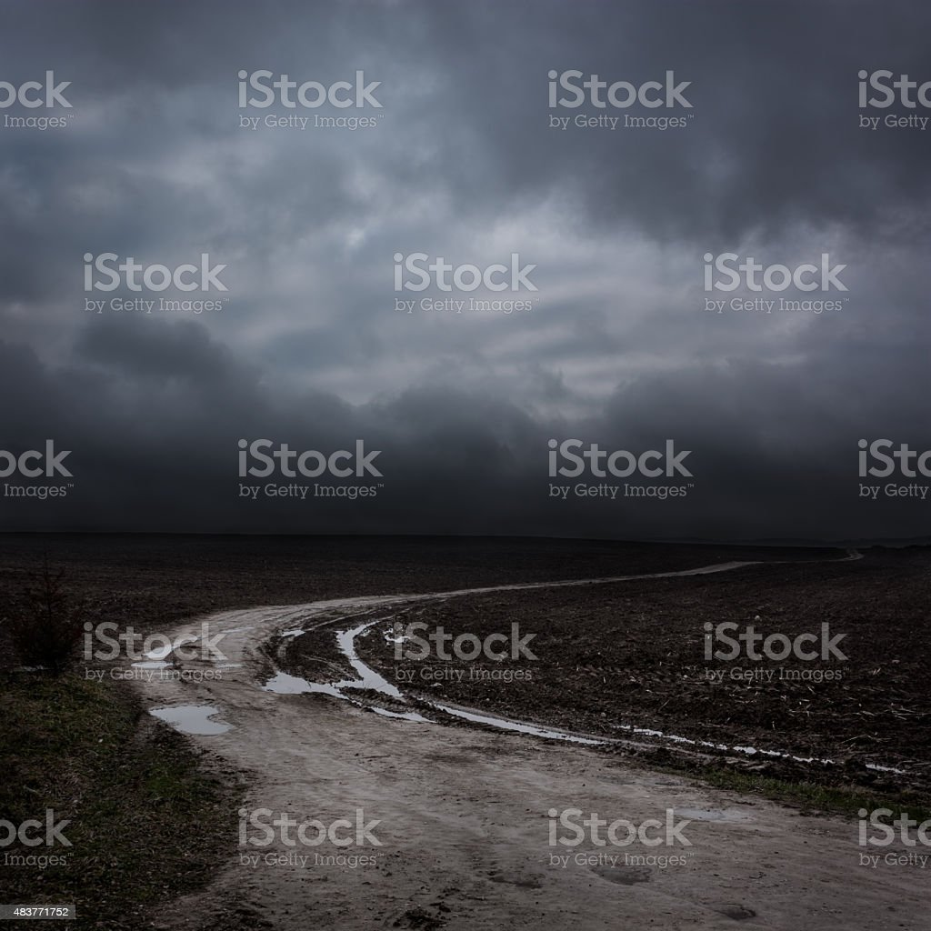 Night Landscape with Country Road and Dark Clouds stock photo