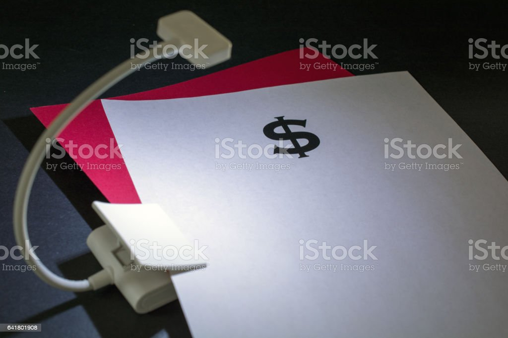 night light, sheet of paper with $     copy space stock photo