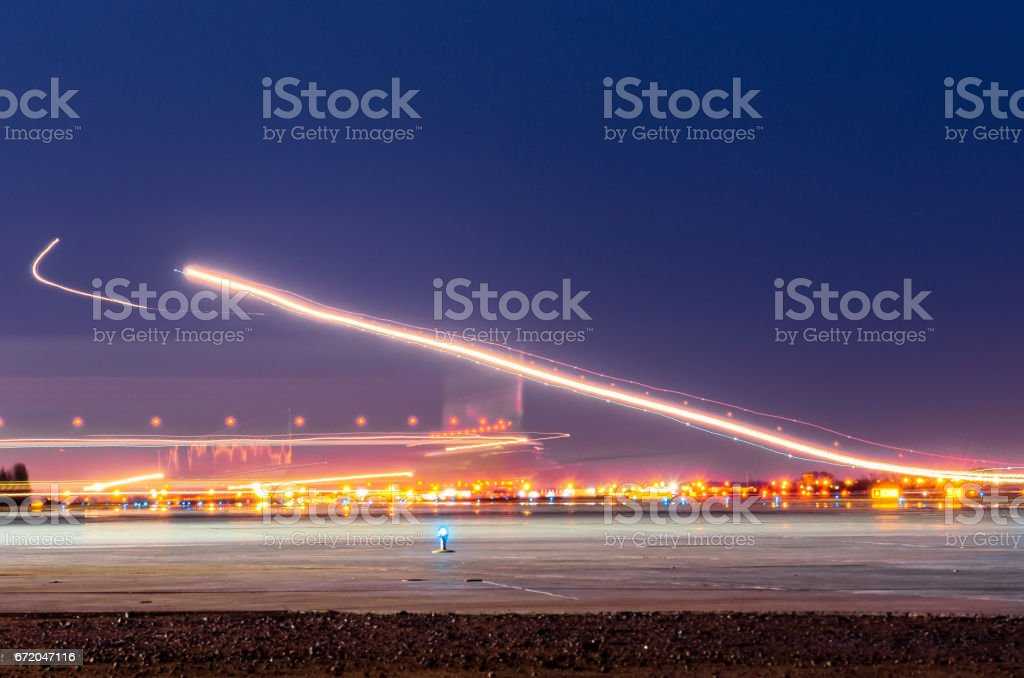 Night lights, tracks of lights in the movement of aircraft on long exposure stock photo