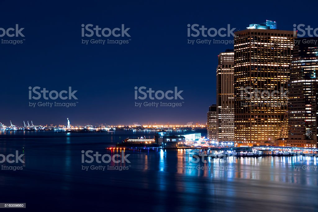 Night Manhattan and the Statue of Liberty stock photo