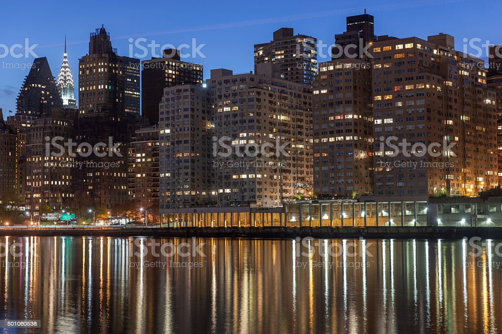Night New York cityscape. View at residential area across river stock photo