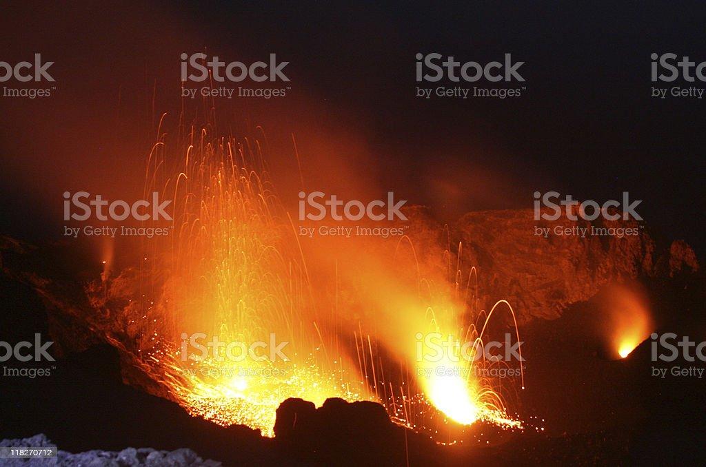 Night of fire, Volcano Stromboli in action stock photo