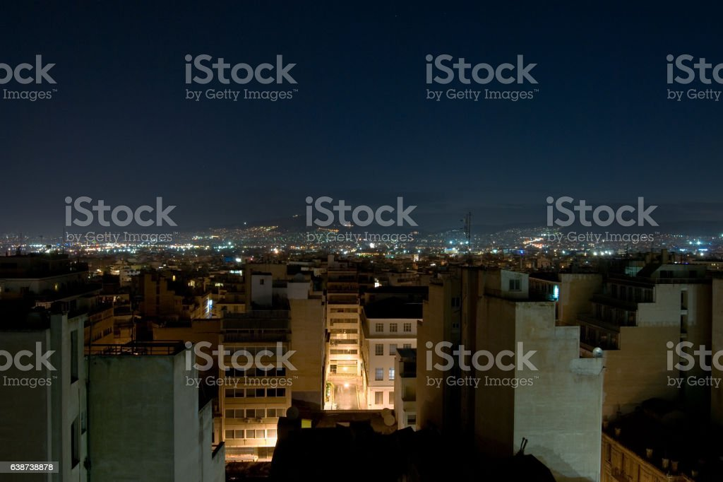 Night panorama of Athens towards the hills with lights. stock photo