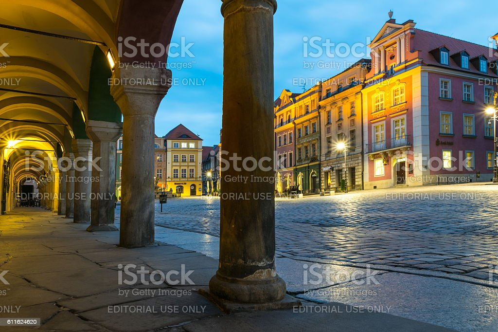Night photo of Poznan  Old Market  with colorful illuminated townhouses. stock photo