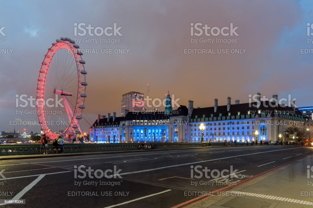 LONDON, ENGLAND - JUNE 16 2016: Night photo of The London Eye and County Hall from Westminster bridge, London, England stock photo