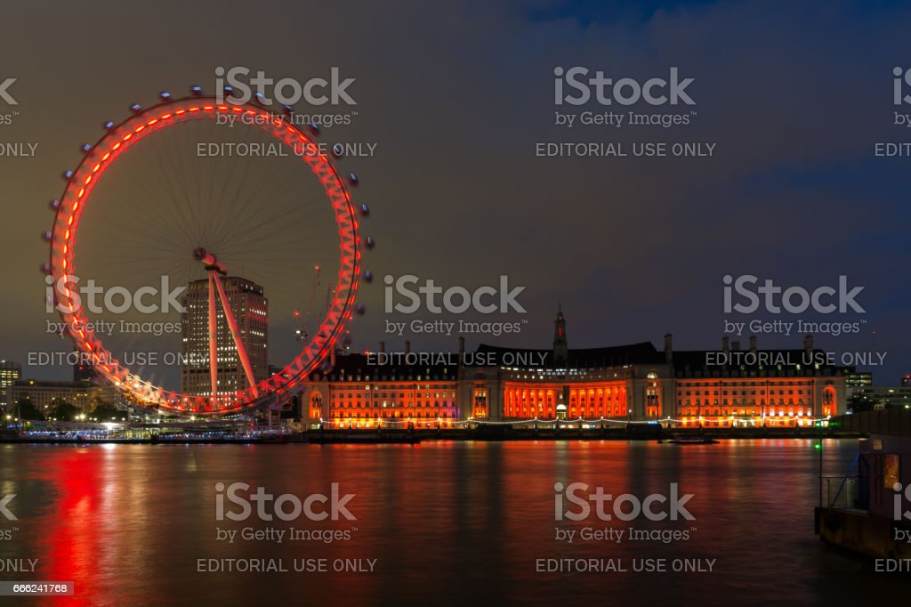 Night photo of The London Eye and County Hall from Westminster bridge, London, England stock photo