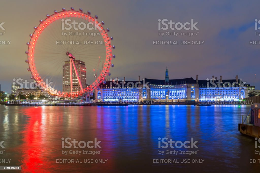 LONDON, ENGLAND - JUNE 16 2016: Night photo of The London Eye and County Hall, London, England stock photo